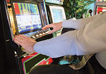 Video Poker Player at Casino